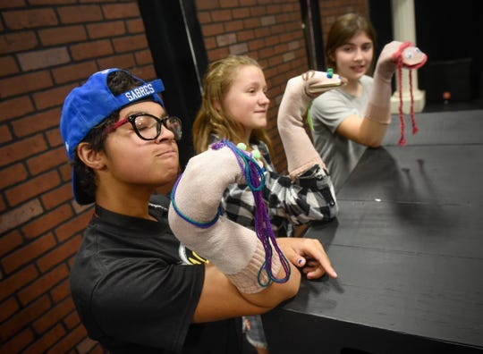 "Puppets are put into use as ""A Day in the Life of Girls"" cast members rehearse a scene from the sketch show Thursday, Aug. 23, at GREAT Theatre in Waite Park."