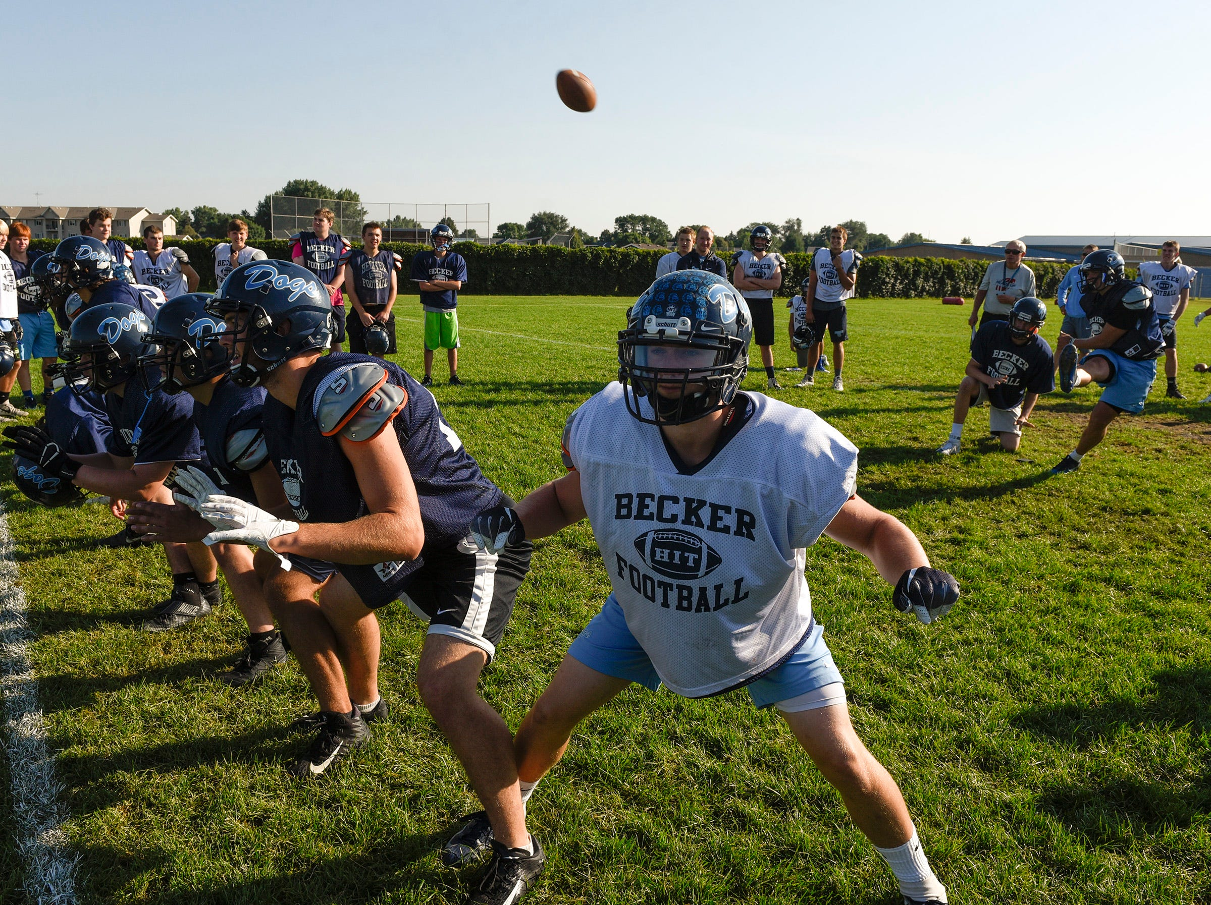 Becker players practice their extra point formation Wednesday, Aug. 22, at the Becker High School.