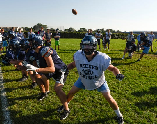 Becker players practice their extra point formation Wednesday, Aug. 22, at Becker High School.