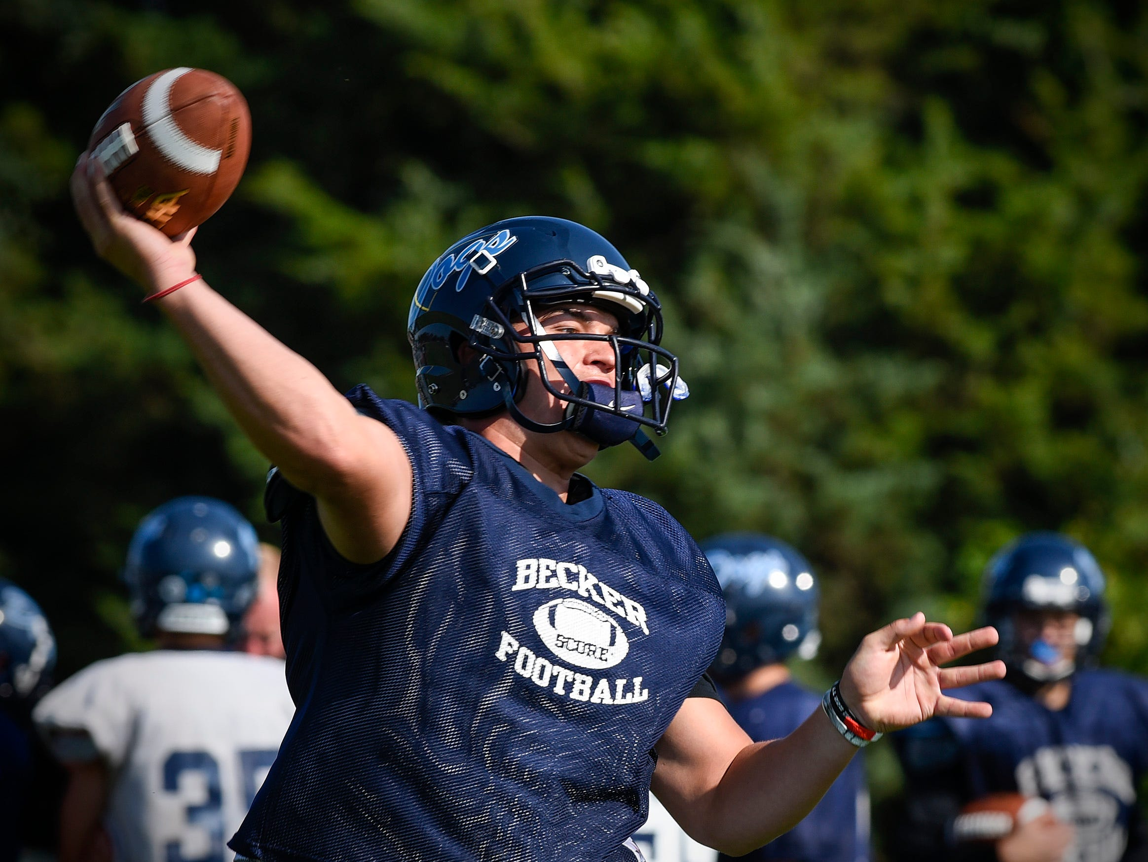 Becker quarterback Josh Fobbe drops back and makes a pass Wednesday, Aug. 22, at the Becker High School.