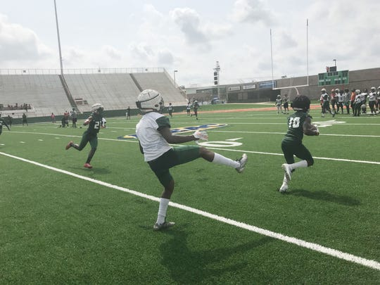 FAMU defensive backfield has dubbed themselves the Jack Boys. Orlando McKinley (10) shows the offense the reason for the moniker as he intercepts a pass during practice.