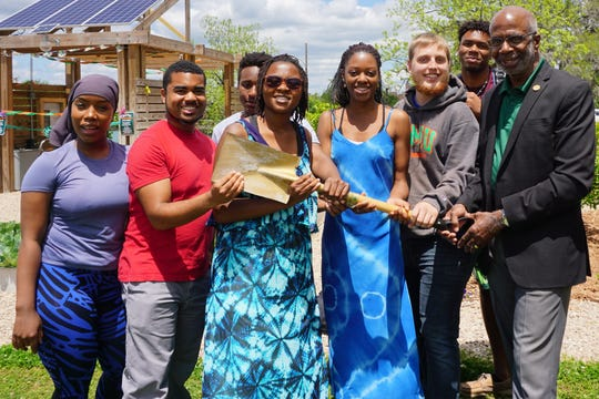 """Florida A&M University President Dr. Larry Robinson recognizes members of the Green Coalition at FAMU with """"The Golden Shovel Award"""" for their involvement at The SEED in spring 2018."""