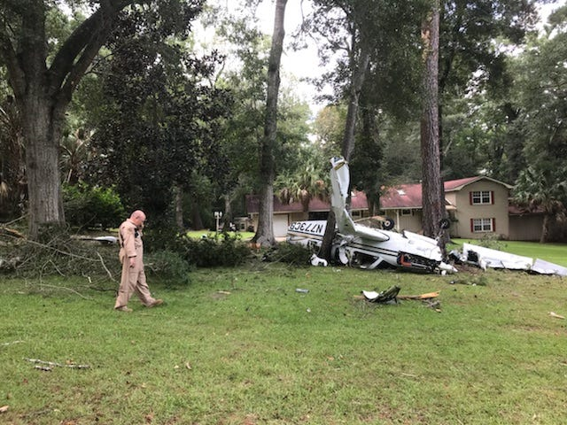 A single-engine plane crashed in a yard in Quincy Friday.