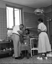 Dr. R.L. Anderson and nurse Lottie Mae Chauis examine an expectant mother at the FAMU Hospital in 1953.