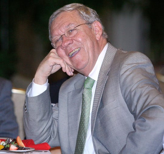 Former Dept. of Children and Families Sec. George Sheldon laughs as a humorous story is told about him during the Children's Week Advocacy Dinner and Reception Monday, April 4, 2011 at the University Center Club in Tallahassee, Fla. Sheldon received the Chiles Advocacy Award at the dinner.