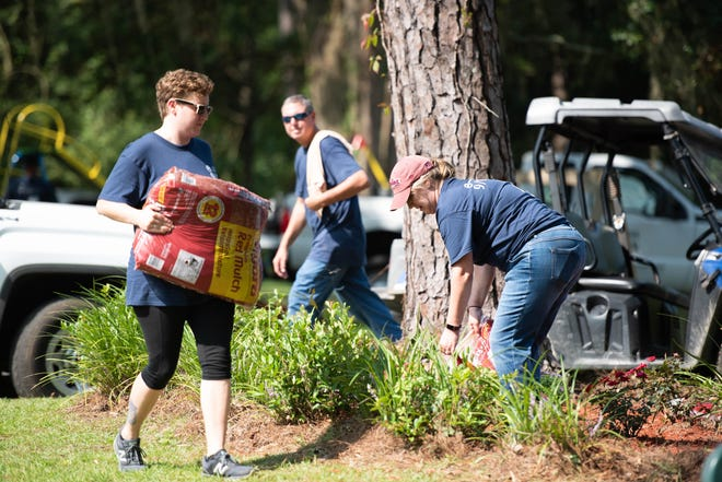 Nearly 80 County employees and community volunteers completed 20 community and housing restoration projects on Thursday.