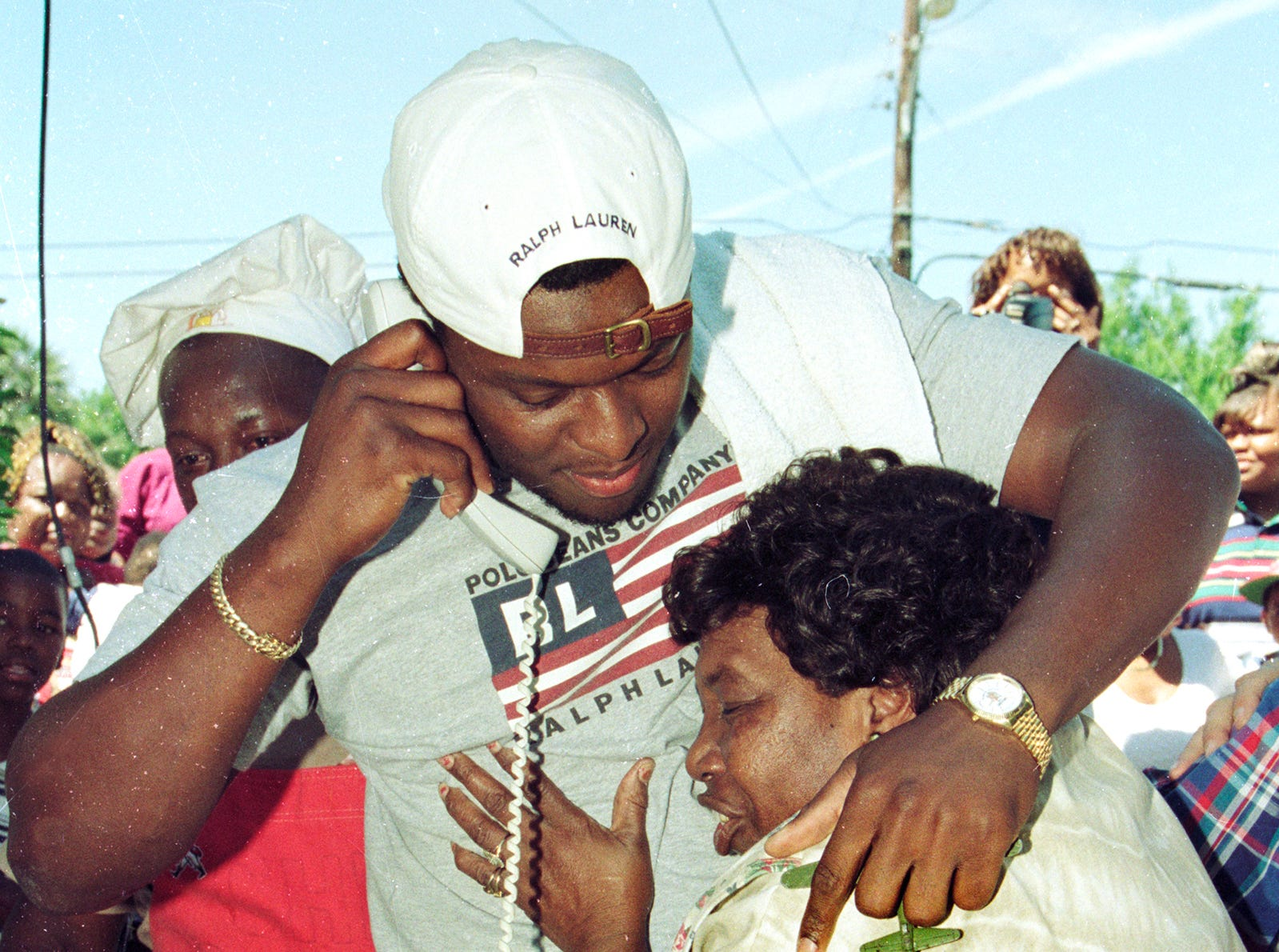 April 19, 1997 - Kenny Holmes gets a hug from his grandmother, Mary Ann Smith, as he talks with the Houston Oilers after the NFL team made him their number one draft pick. The Oilers made Holmes the 18th overall pick in the first round of the NFL draft. More than 50 friends and relatives gathered at the Holmes' residence in Gifford for a barbecue so they could watch the draft together. He was a defensive end standout at both Vero Beach High School and the University of Miami.