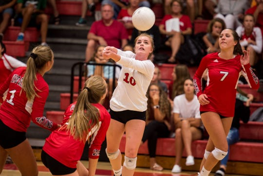 Vero Beach's Olivia Forman returns the ball, as teammate Eliza Tierney (right) moves into position, against Martin County during the first game of the high school volleyball match Thursday, Aug. 23, 2018, at Vero Beach High School.