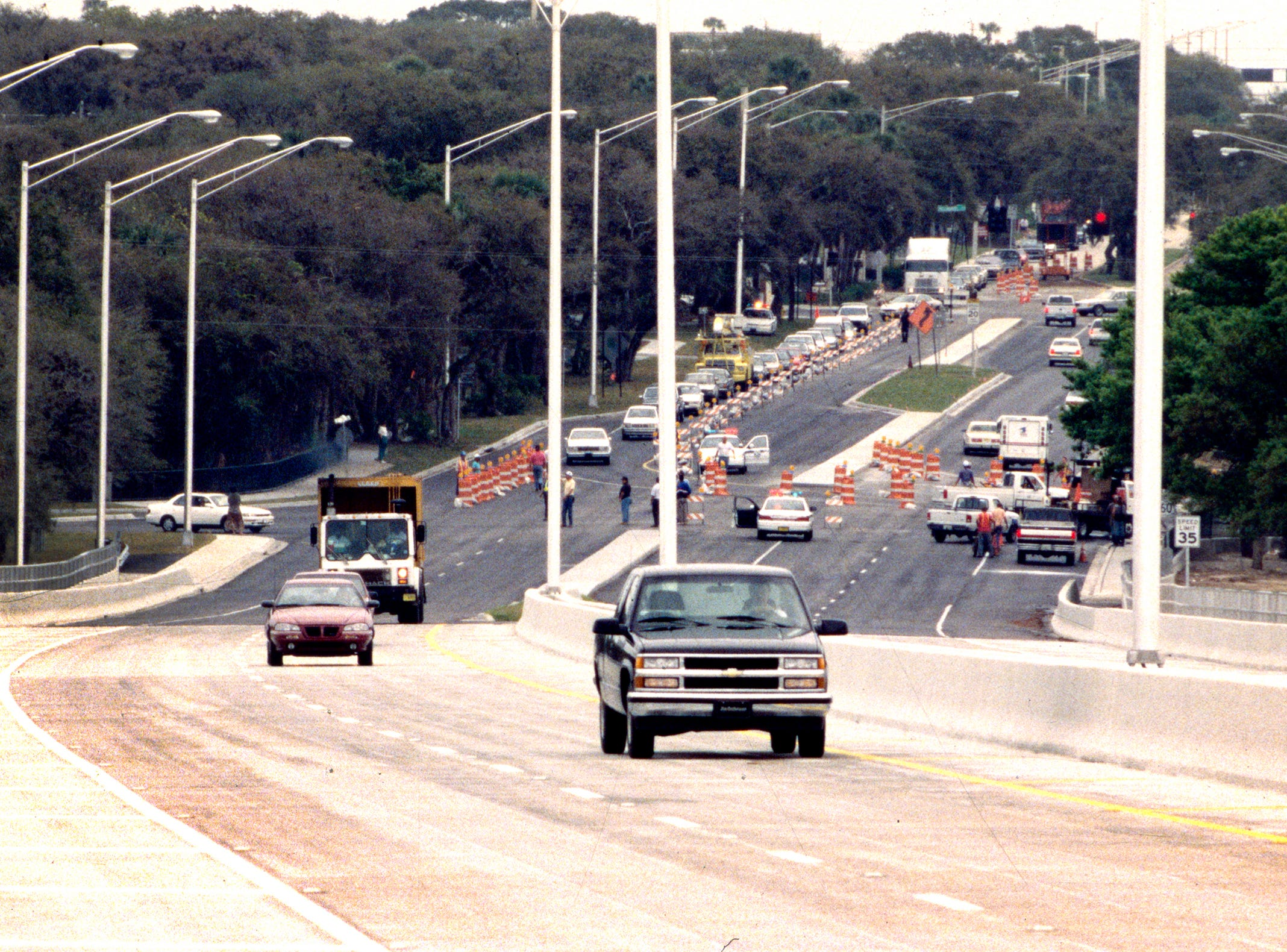 March 1, 1995 - The first motorists on the brand new Merrill P. Barber Bridge were allowed to start over the span at 11:33 a.m. in Vero Beach. An early morning rainfall delayed the opening of the $26 million bridge, until they were able to dry the pavement and put down road striping. The first person to drive over the bridge was Jim Greer.
