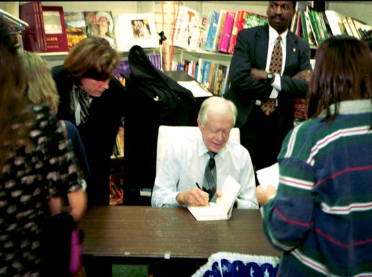 """December 9, 1997 - Former President Jimmy Carter autographed his latest inspirational book, """"Sources of Strength: Meditations on Scripture for a Living Faith,"""" at the Vero Beach Book Center. Carter's book contained many of the Sunday school lessons he has taught at Maranatha Baptist Church in Plains, Ga. More than 2,500 people were on hand for the book signing."""