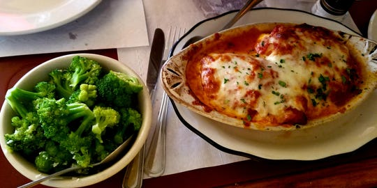 Luna Italian Cuisine's eggplant rollatini was stuffed with imported ham, ricotta, and meat sauce,  topped with mozzarella, tomato sauce, and baked in a casserole dish. Here it was served with a side of broccoli.