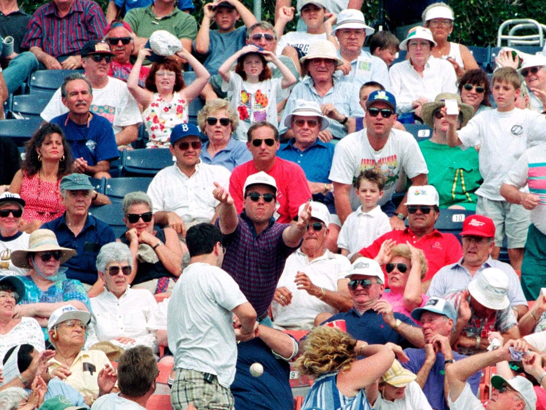 March 27, 1996 - The final game of the Los Angeles Dodgers spring training schedule in 1996, was held at Holman Stadium in Vero Beach. The game was played against the Montreal Expos, with the Dodgers winning 4-2. Some lucky fans got the foul ball, as Expos catcher Tim Spehr watched from the edge of the field.
