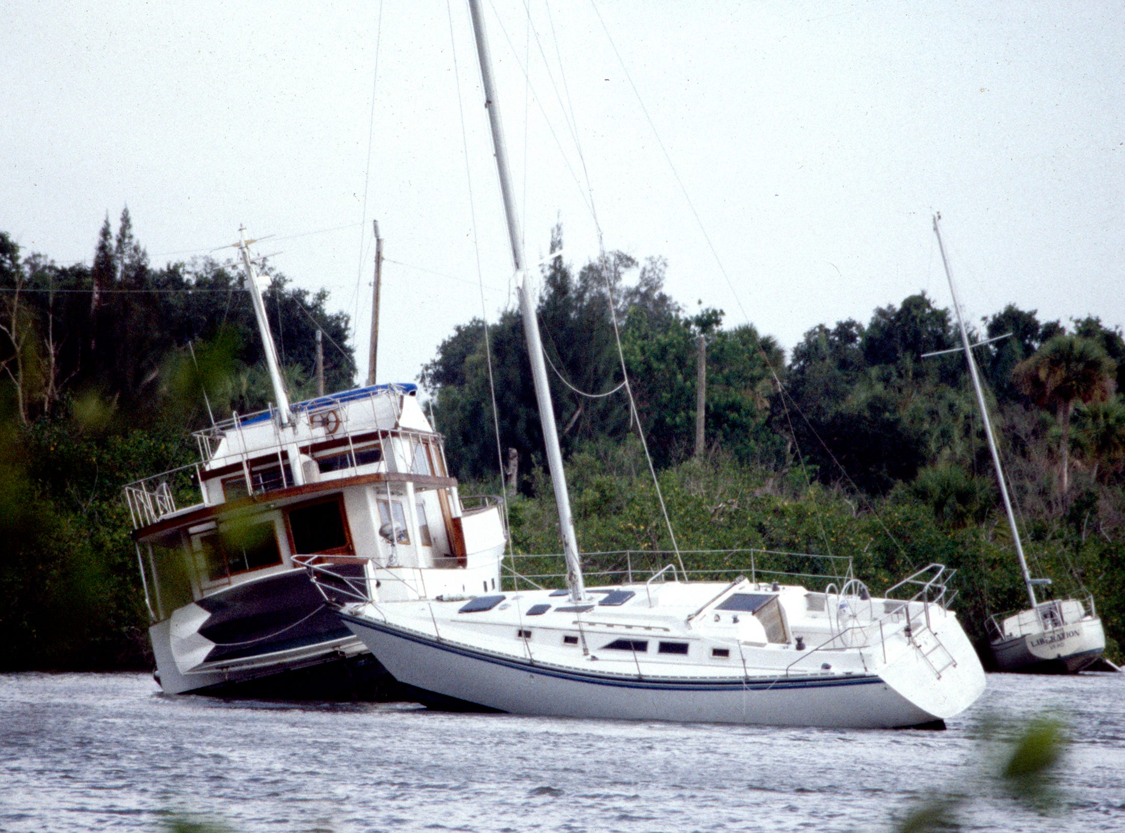 August 2, 1995 - Three boats along Jungle Trail were pulled from their moorings and were run aground during Hurricane Erin. They were sitting haphazardly in the Indian River Lagoon just north of Jones Pier. Erin's eye came ashore near Vero Beach, and was responsible for 11 deaths.