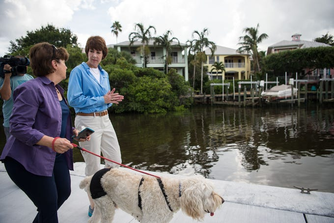 "Democratic gubernatorial hopeful Gwen Graham (center) talks with Edie Widder, CEO and senior scientist at the Ocean Research & Conservation Association, walking her dog Yankee Doodle, on Friday, Aug. 24, 2018, along the boardwalk at Shepard Park in Stuart. Graham visited ahead of primary elections to speak with Widder and other ORCA representatives about the harmful effects of blue-green algae in Florida. ""This is not a Democratic or Republican or Independent issue,"" Graham said, ""the environment, our water, our water quality, our water quantity issues — this is not about politics, it's about preserving the future for the state of Florida."""