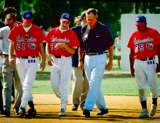 """Former President George H. W. Bush talked baseball with some of the East West Ambassador baseball players July 7, 1994, at Dodgertown in Vero Beach. He was there to congratulate the 350 international players for their efforts in carrying American Goodwill abroad. He designated the team as one of his """"thousand points of light."""" The team was a non-profit organization that sent youth baseball teams abroad as goodwill ambassadors."""
