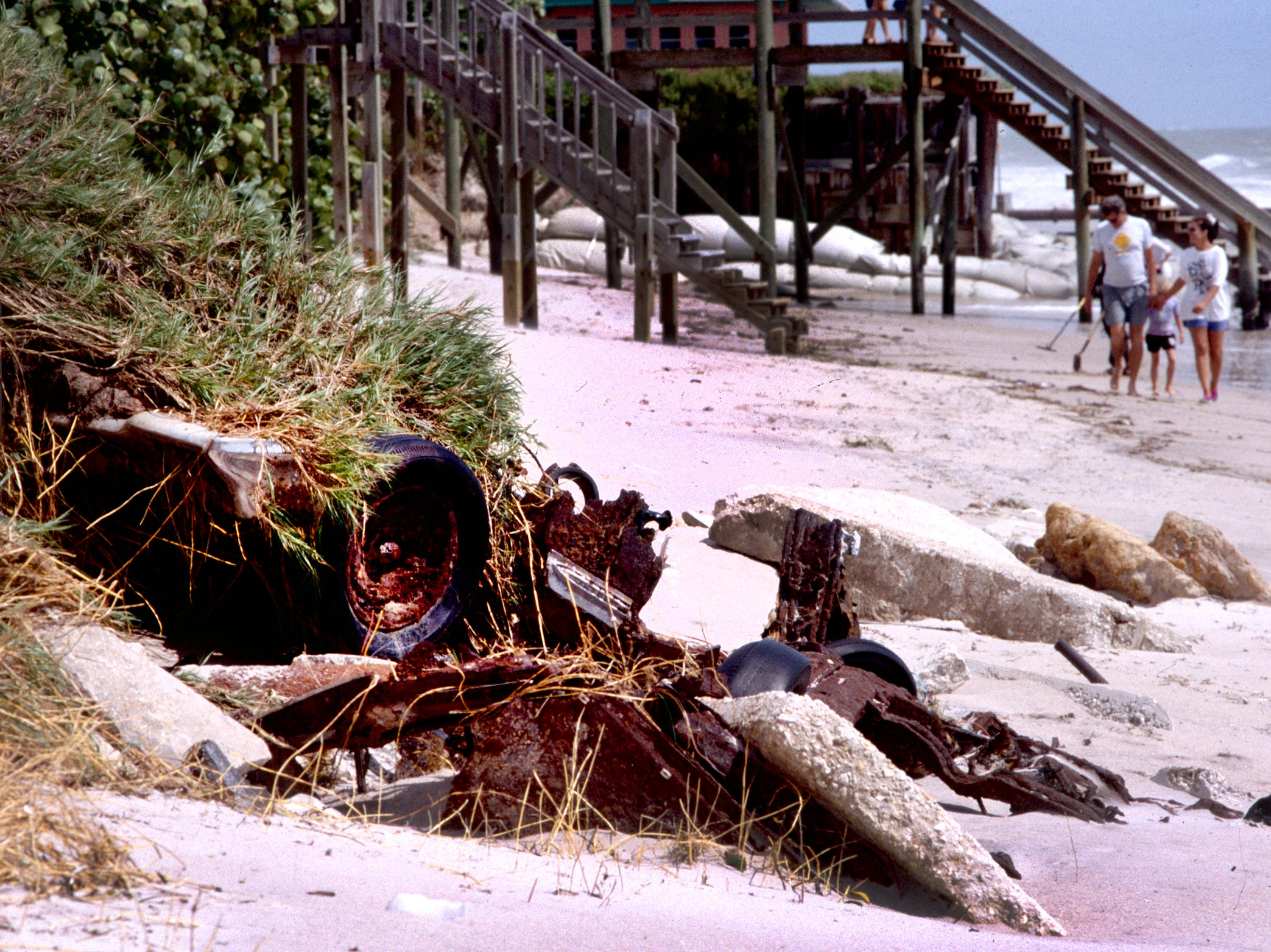 August 2, 1995 - Beaches that took a pounding during Hurricane Erin the night she came ashore, including the area near the Flamevine Lane access. Cars that were buried in the dune line before Hurricane David in 1979 to preserve the dune line were uncovered again.
