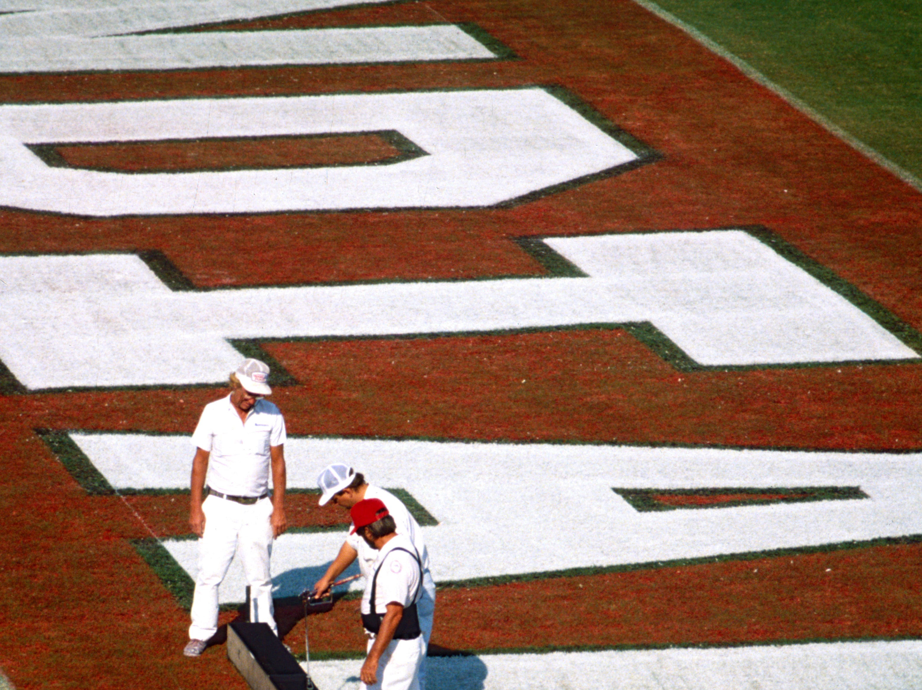December 2, 1993 - School painters were busy getting Vero Beach High School's Citrus Bowl field ready for a playoff football game they had scheduled against Miami Senior in the Class 5A playoffs. Leo Franks (from left), Jimmy Childers and Charlie Windheuser worked on the end zones.