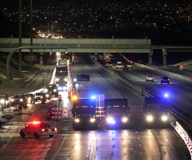 An El Paso police officer (lower left) assists the Texas Department of Transportation as they exit westbound traffic onto the Executive Center on ramp during overnight construction work.