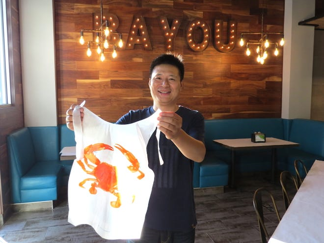 """It's a casual setting for families to enjoy good food,"" says Joe Zhou, owner of Captain's Cajun Boil at The Collection at RiverPark in Oxnard. Bibs and gloves are available for patrons dining on its seafood-boil dishes of clams, shrimp, crabs and more."