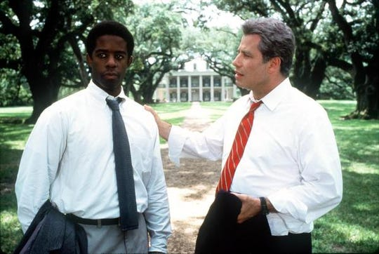 "Adrian Lester, left, and John Travolta star in the 1998 film ""Primary Colors."""