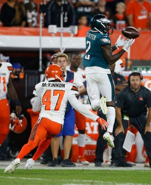 Philadelphia Eagles wide receiver DeAndre Carter (2) catches a pass against Cleveland Browns defensive back Jeremiah McKinnon (47) during the second half of an NFL preseason football game, Thursday, Aug. 23, 2018, in Cleveland. (AP Photo/Ron Schwane)