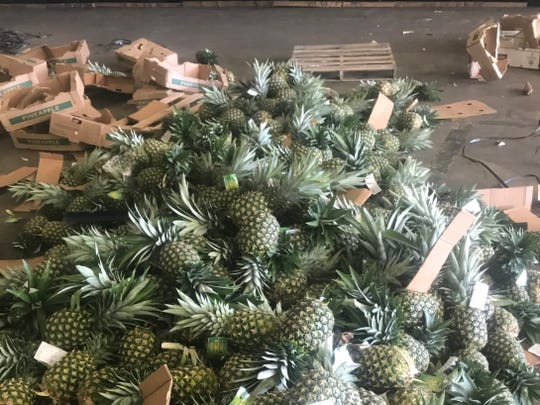 Pineapples are stacked next to empty boxes at the Port of Wilmington.
