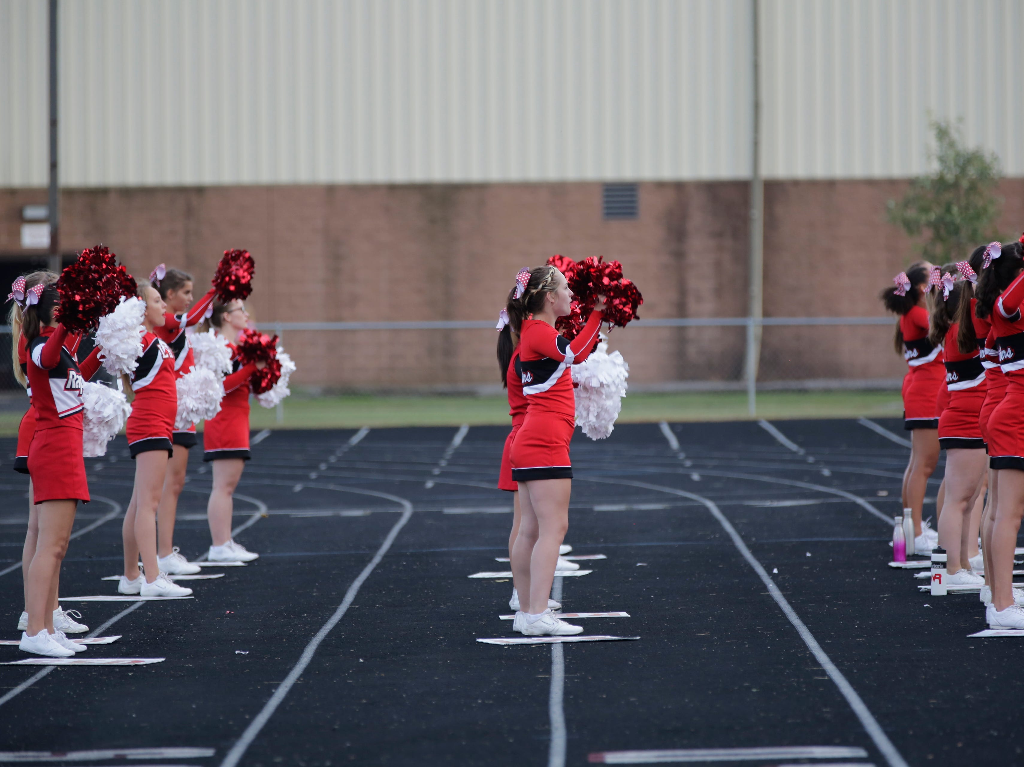 The Wisconsin Rapids cheerleaders lead a cheer during a game between Wisconsin Rapids and Kimberly at Wisconsin Rapids Lincoln High School Thursday, August 23, 2018.