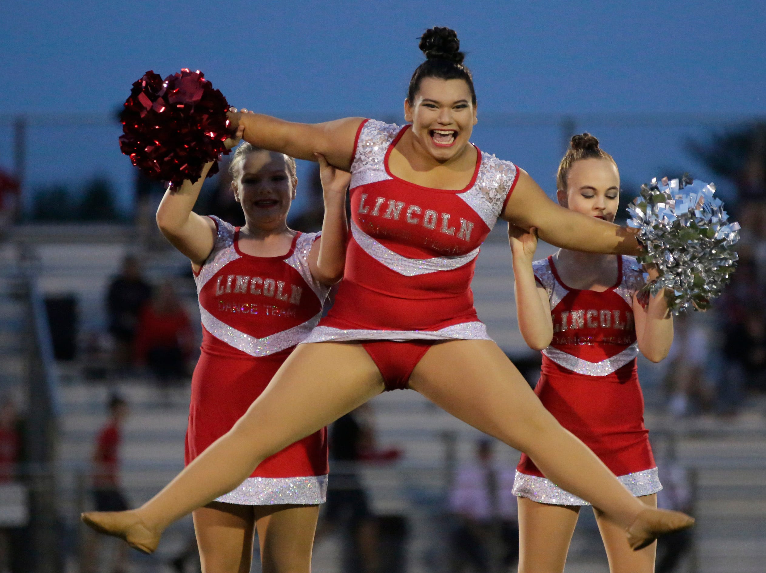 The Wisconsin Rapids' dance team performs at halftime during a game between Wisconsin Rapids and Kimberly at Wisconsin Rapids Lincoln High School Thursday, August 23, 2018.