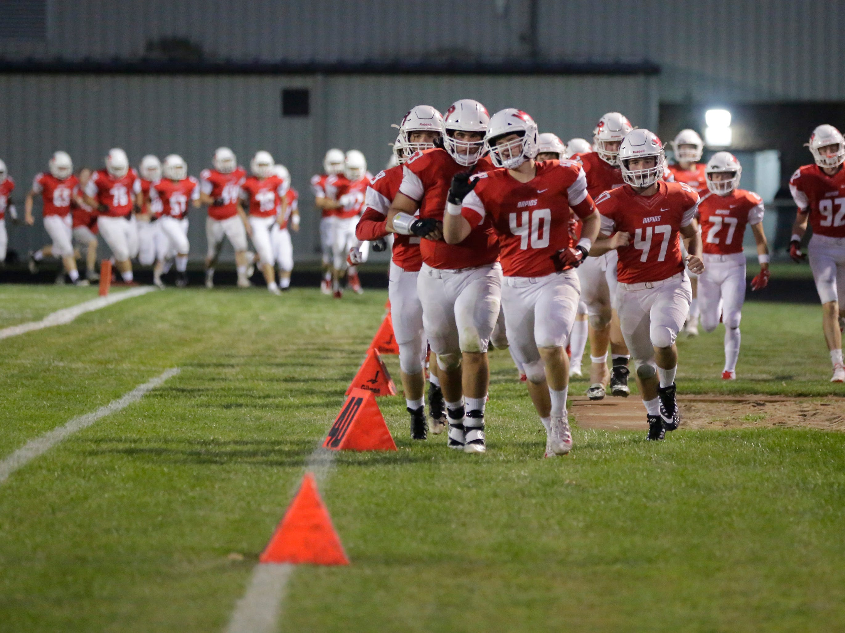The Wisconsin Rapids football team returns to the field after half time during a game between Wisconsin Rapids and Kimberly at Wisconsin Rapids Lincoln High School Thursday, August 23, 2018.