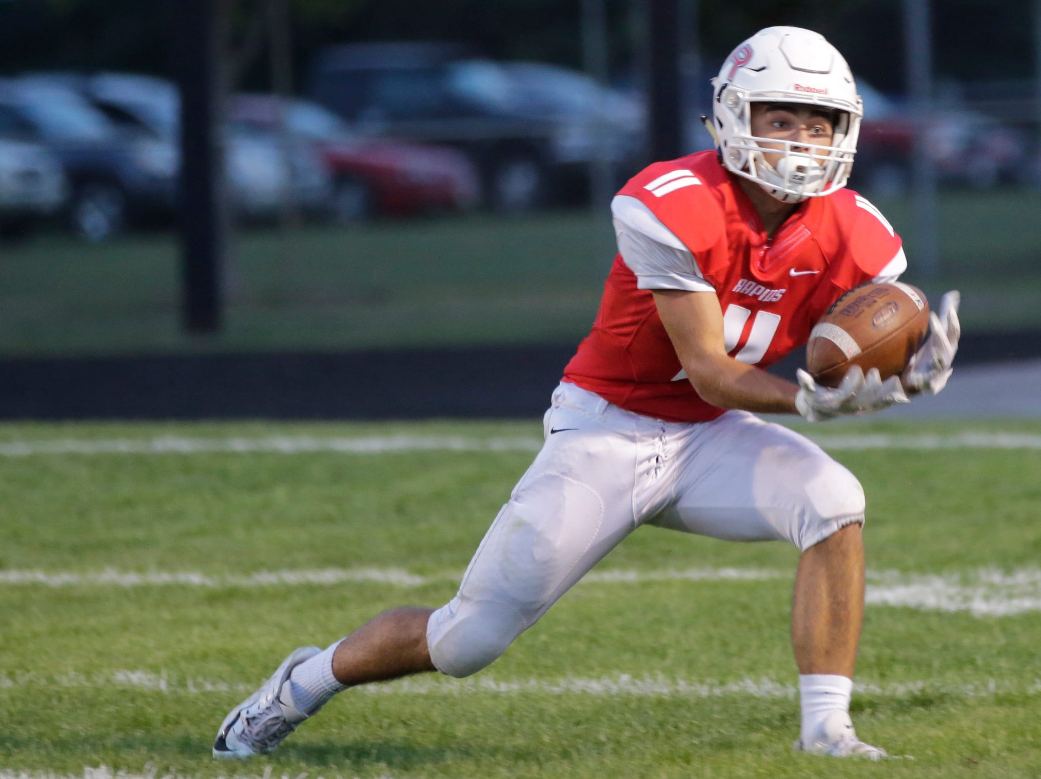 Wisconsin Rapids' Nathan Schooley (11) catches a kick during a game between Wisconsin Rapids and Kimberly at Wisconsin Rapids Lincoln High School Thursday, August 23, 2018.