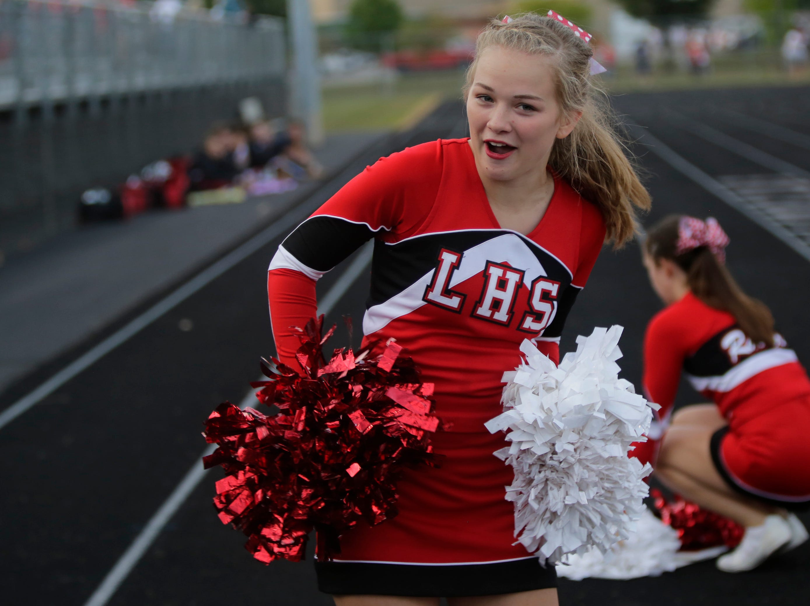 A Wisconsin Rapids cheer leader dances during a game between Wisconsin Rapids and Kimberly at Wisconsin Rapids Lincoln High School Thursday, August 23, 2018.