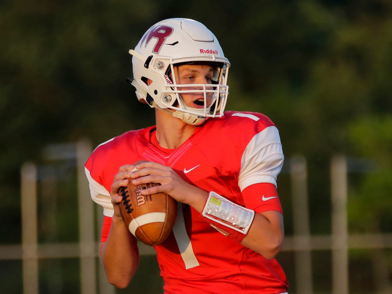Quarterback Austin Pelot (1) looks to pass during a game between Wisconsin Rapids and Kimberly at Wisconsin Rapids Lincoln High School Thursday, August 23, 2018.