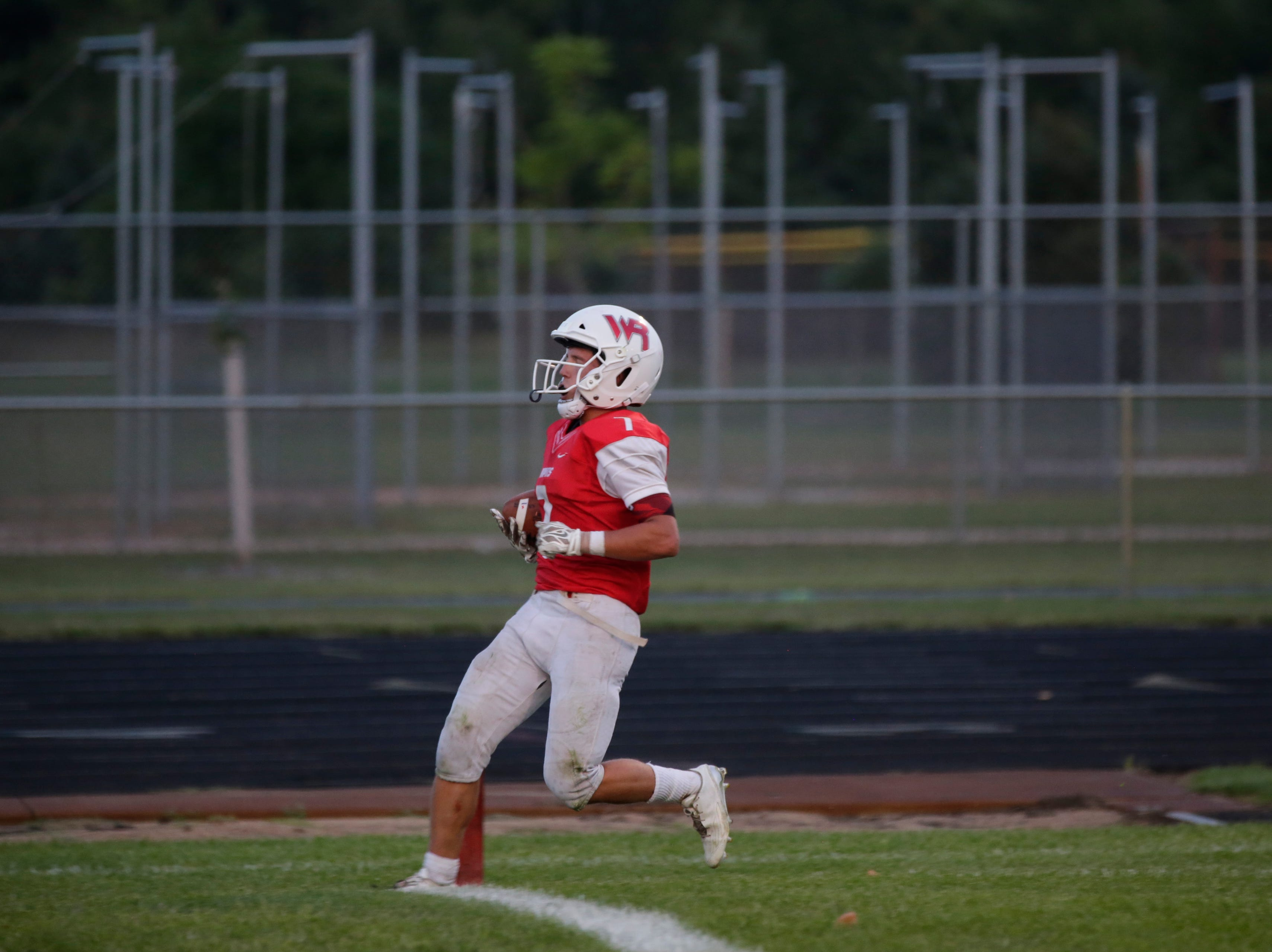 Wisconsin Rapids' Nash Coombs (7) scores a touchdown that was overturned by a penalty during a game between Wisconsin Rapids and Kimberly at Wisconsin Rapids Lincoln High School Thursday, August 23, 2018.