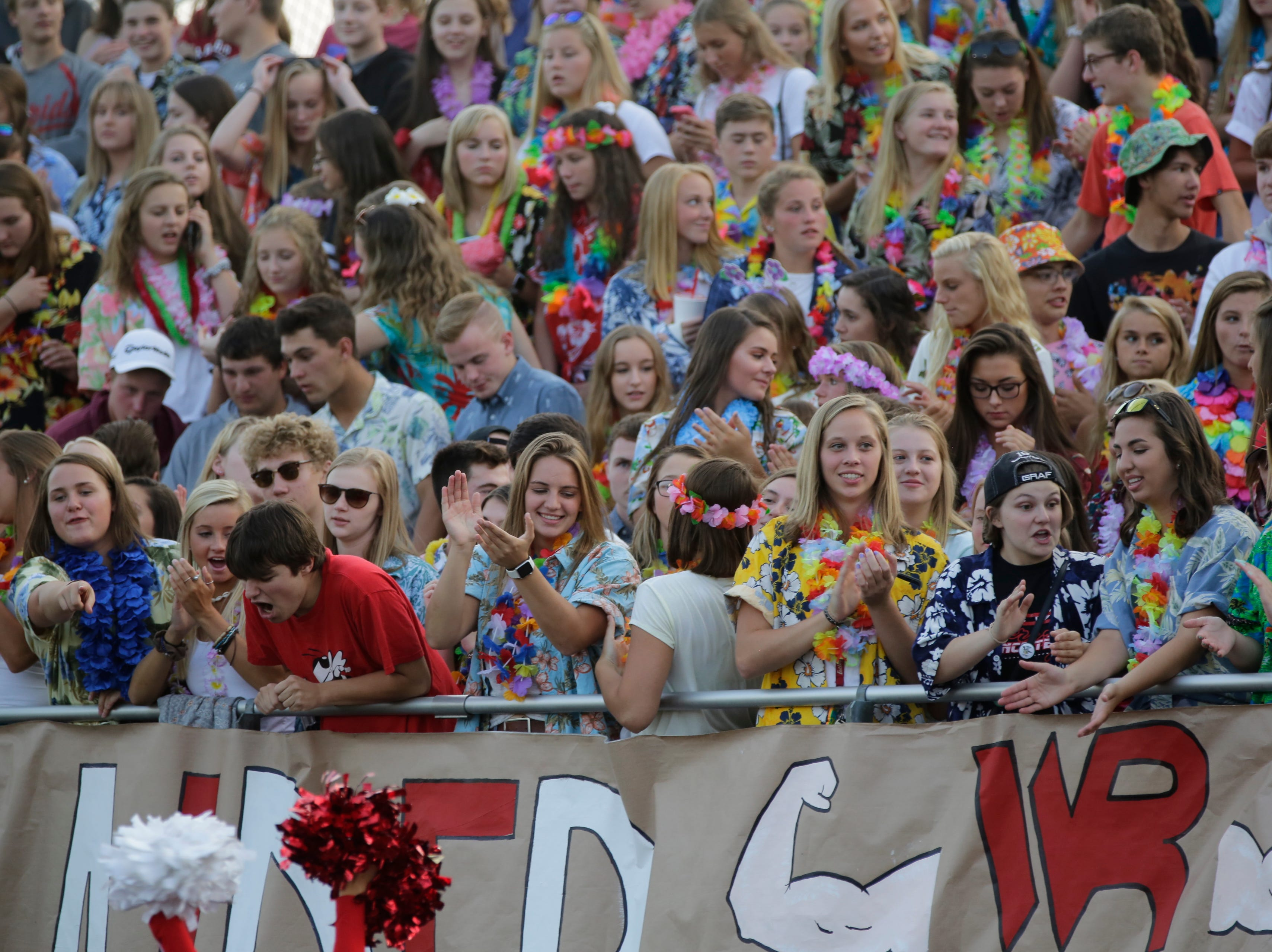The Wisconsin Rapids student section cheers during a game between Wisconsin Rapids and Kimberly at Wisconsin Rapids Lincoln High School Thursday, August 23, 2018.