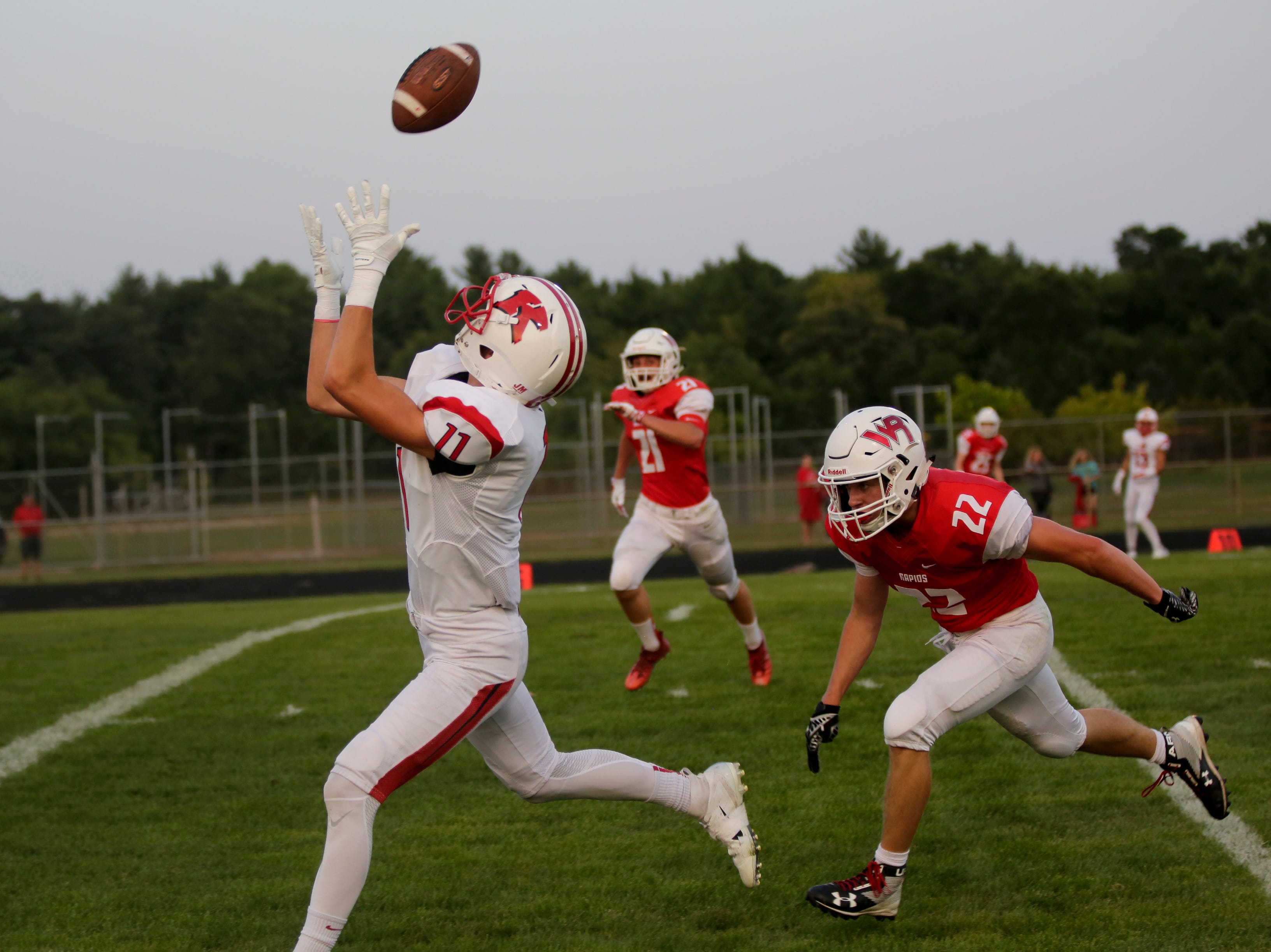Kimberly's Conner Wnek (11) makes a catch to score a touchdown during a game between Wisconsin Rapids and Kimberly at Wisconsin Rapids Lincoln High School Thursday, August 23, 2018.