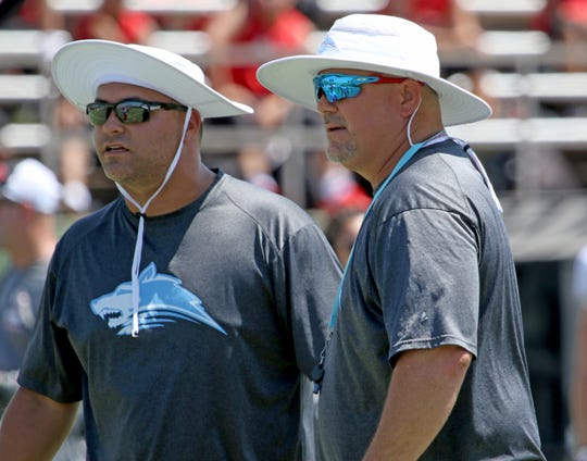 Hirschi head football coach Danny Youngs and defensive coordinator Joseph Carroll watch as the Huskies participate in a scrimmage with Wichita Falls High School on Aug. 24, 2018.