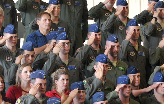 Sheppard Air Force Base personnel salute during a ceremony held celebrating the 80th Training Commander, Colonel Russel Driggers, Friday morning.