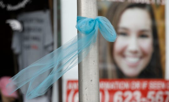 A ribbon for missing University of Iowa student Mollie Tibbetts hangs on a light post, Tuesday, Aug. 21, 2018, in Brooklyn, Iowa.
