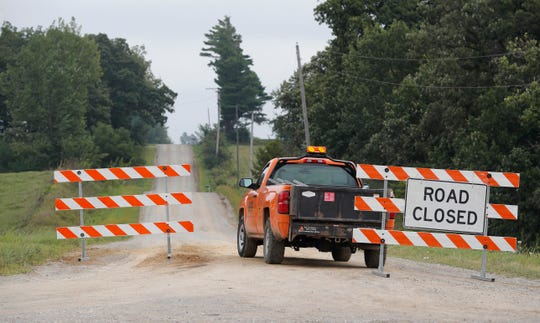A county truck blocks a gravel road, Tuesday, Aug. 21, 2018, near Brooklyn, Iowa, where the body believed to be that of 20-year-old college student Mollie Tibbetts was discovered.