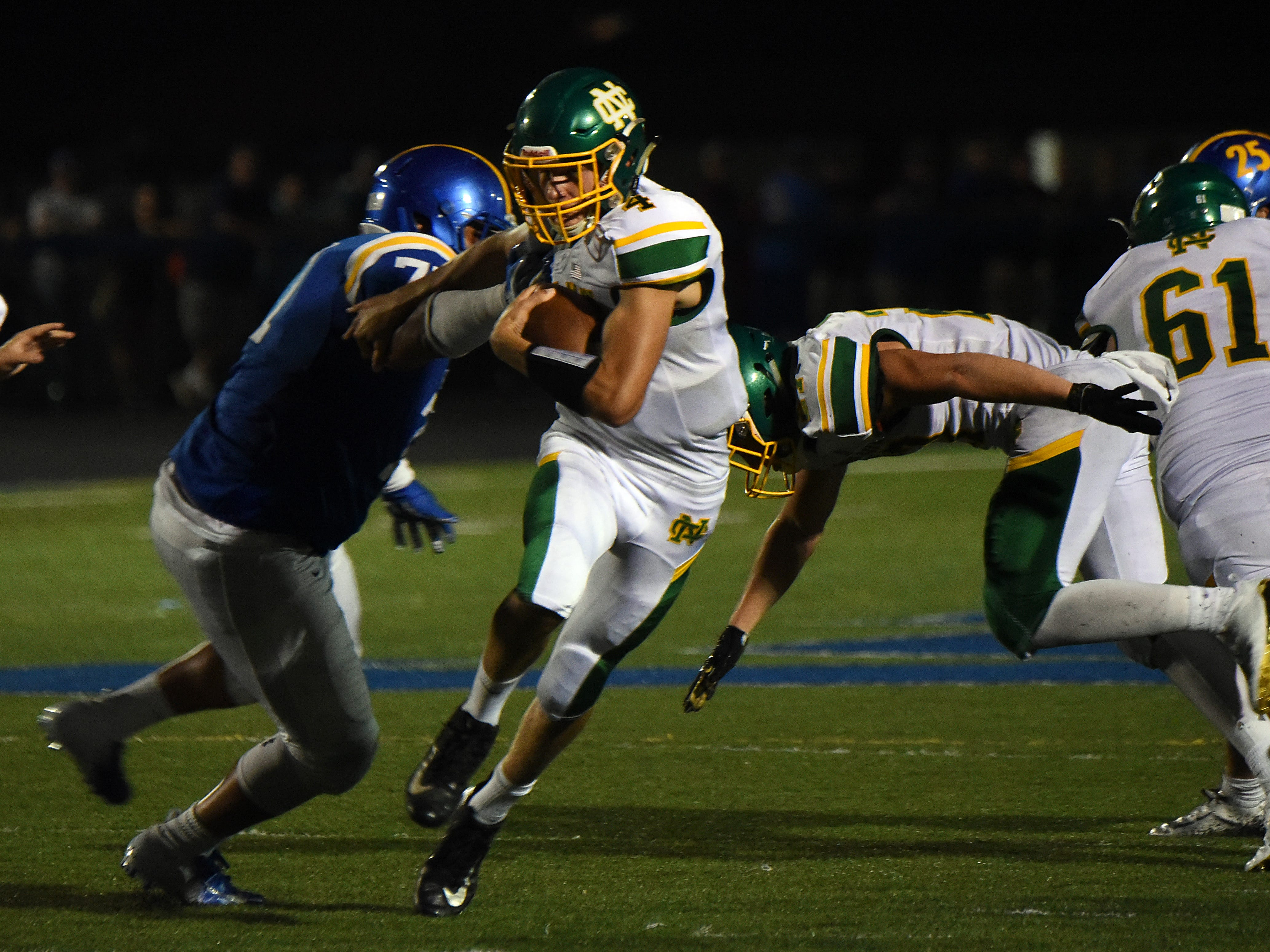 Newark Catholic quarterback Matt Carlisle finds an opening in the Maysville defense during Thursday night's season opener at Maysville. The Green Wave defeated the Panthers 17-13.