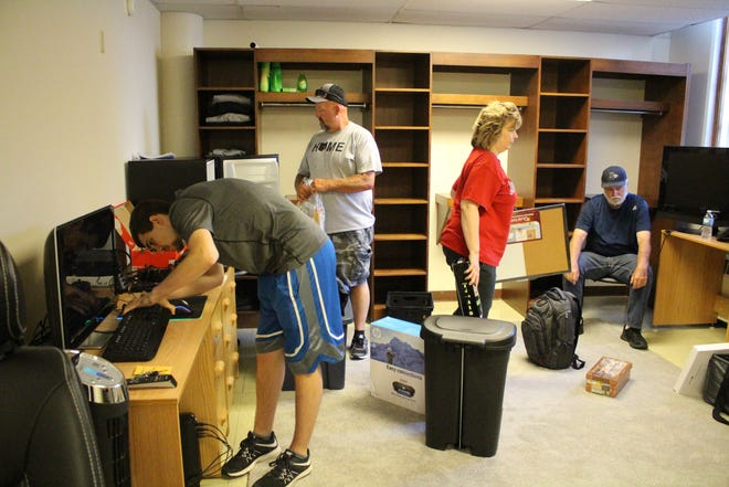 Maxwell Moffo and his family sets up his new dorm room at Muskingum University.