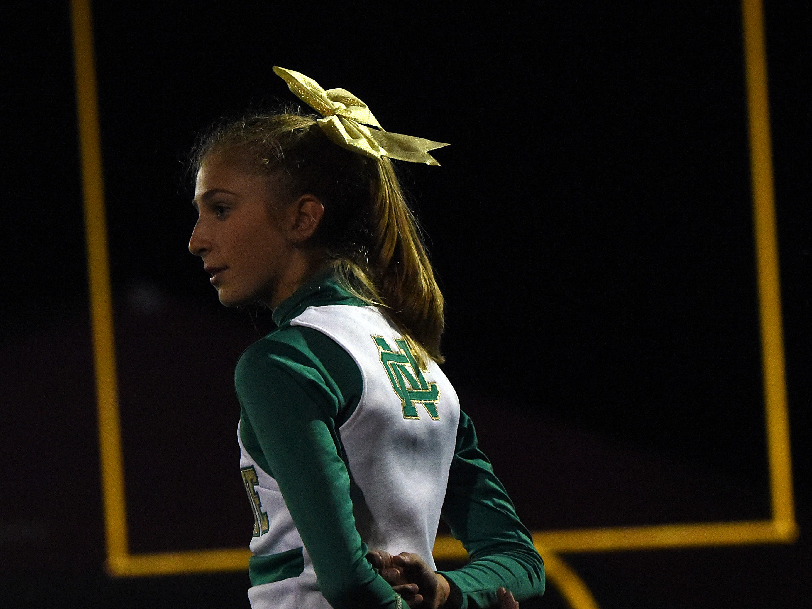 Newark Catholic freshman Mary Capretta on the sidelines for the Green Wave on Thursday night at Maysville.
