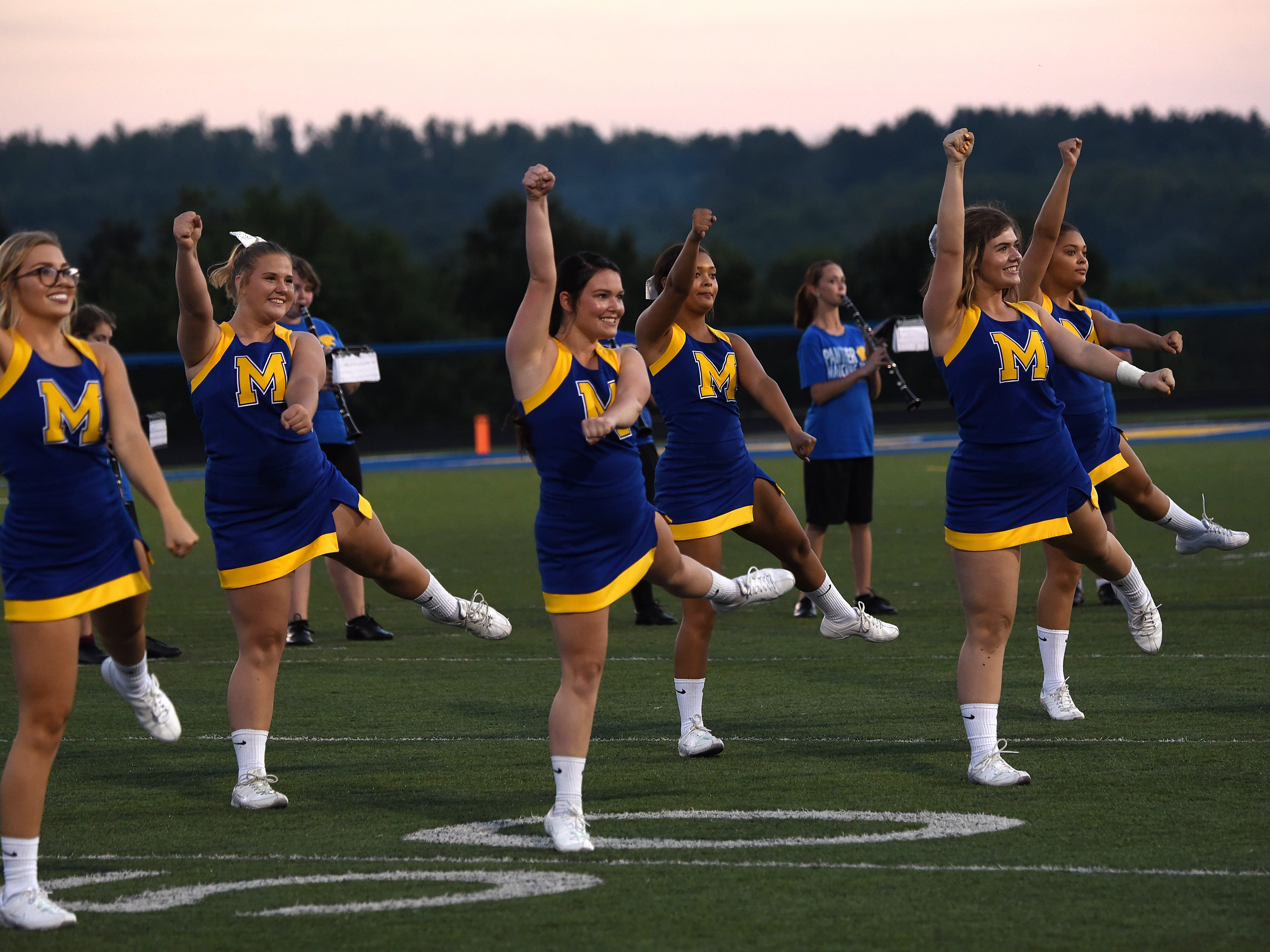 "Maysville cheerleaders dance to ""Barbara Ann"" during halftime of their season opening game against Newark Catholic."
