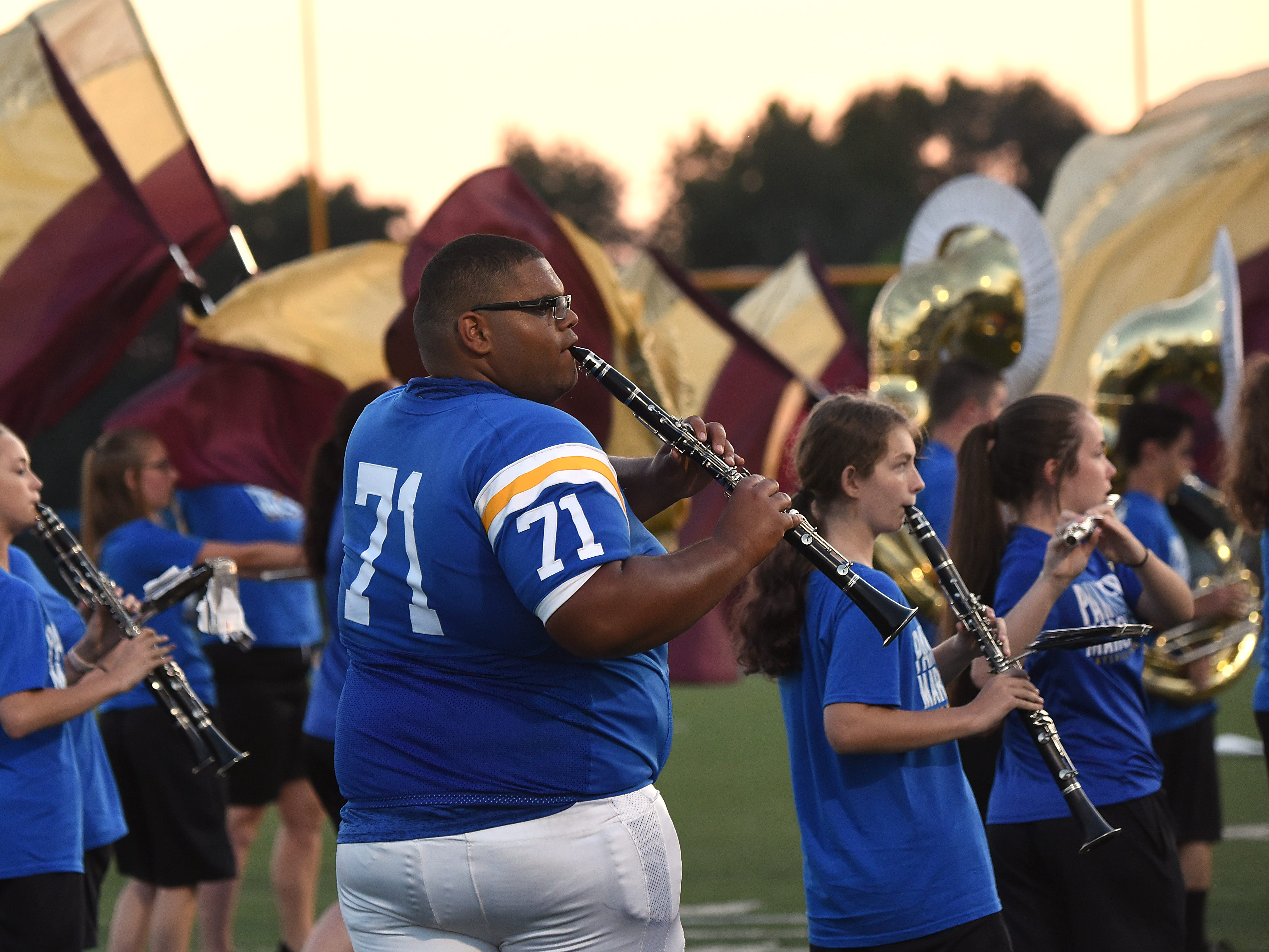Maysville football player Jakob Plummer performs with the marching band during halftime on Thursday, Aug. 23, 2018.