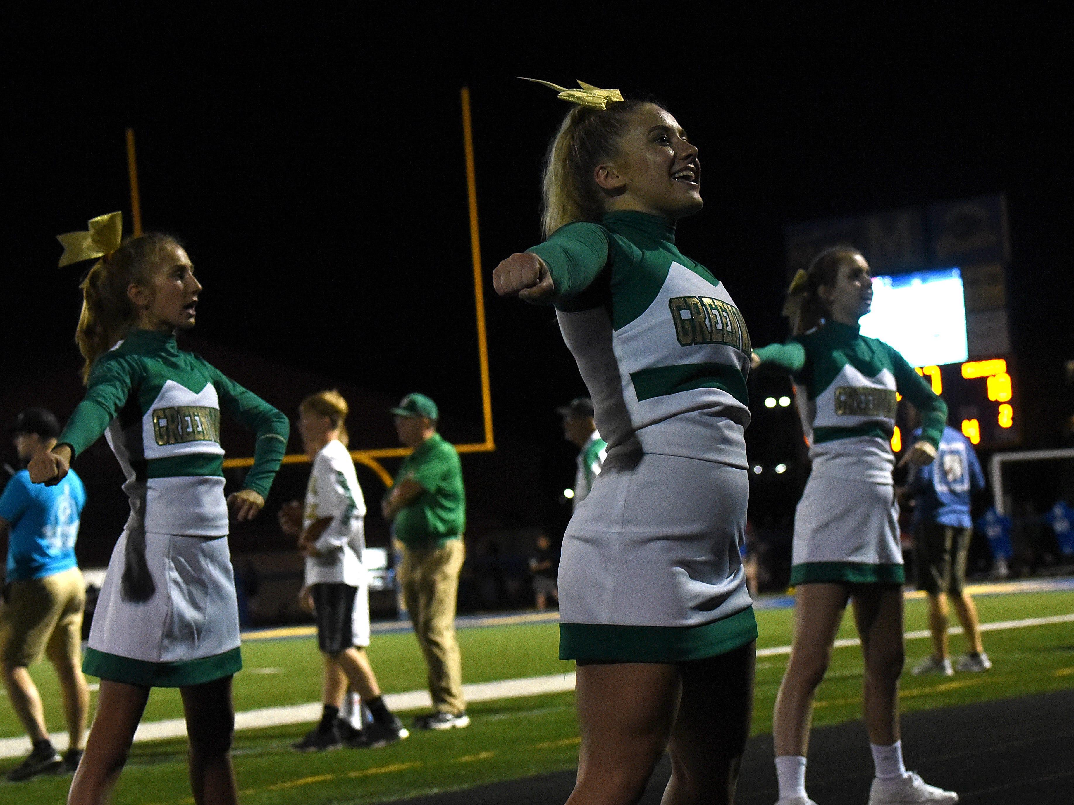 Newark Catholic senior Maddi Muetzel cheers for the Green Wave on Thursday, Aug. 23, 2018 at Maysville.