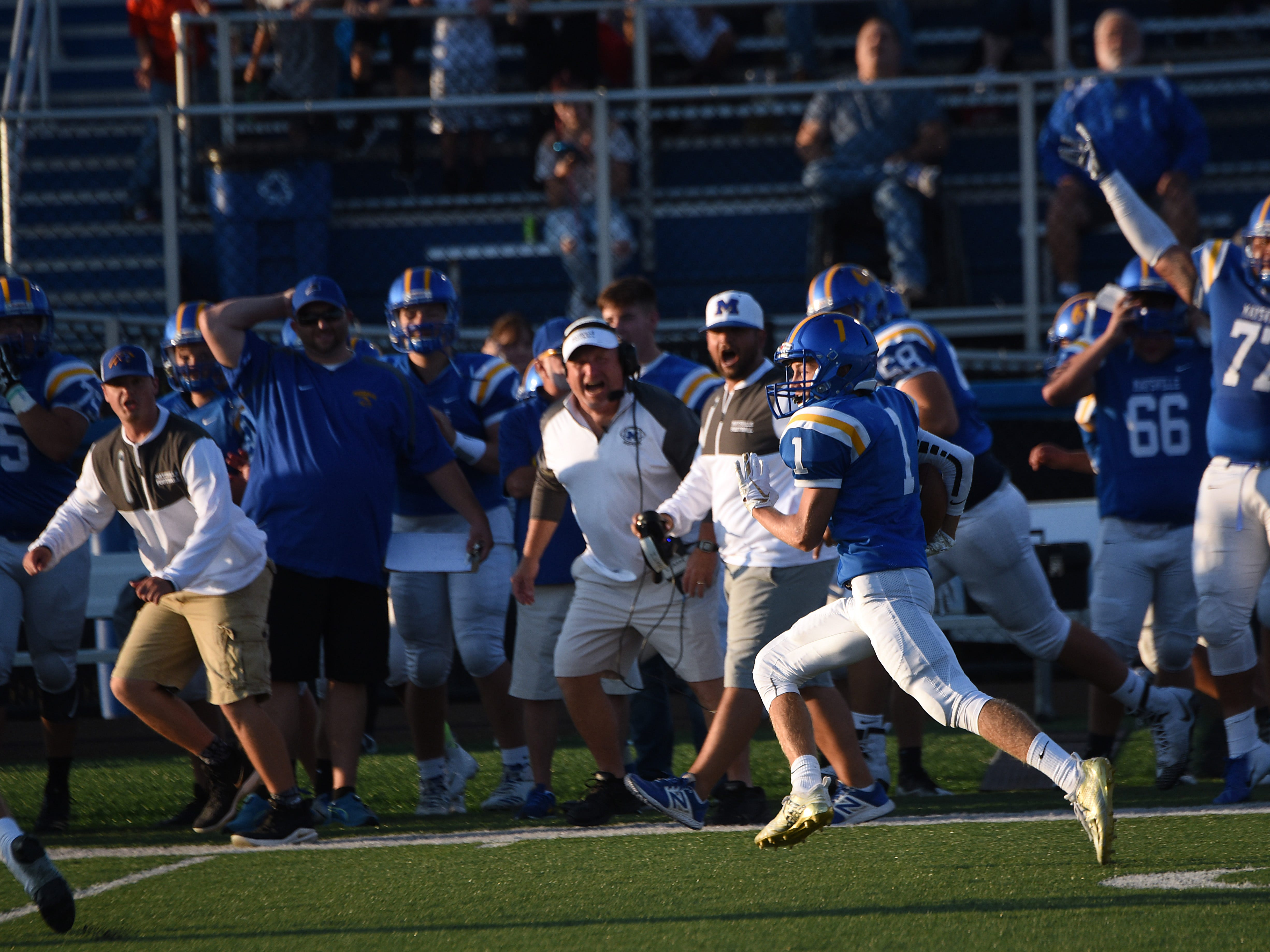 Maysville junior wide receiver Mason Swauger carries the ball as the sideline cheers him on during Thursday's season opening game against Newark Catholic. The Panthers fell 17-13 to the Green Wave.