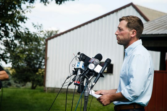 Dane Lang, co-owner of Yarrabee Farms, speaks to the press with his father and co-owner Craig Lang, on their family's farm on August 22, 2018, in Brooklyn, Iowa. Cristhian Rivera, a former employee at the farm, has been charged with the murder of Mollie Tibbetts.