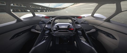 The cockpit in the Audi PB 18 e-tron electric supercar concept is designed to allow the driver's seat to slide into the center of the vehicle, optimizing the driver's vision of the road.