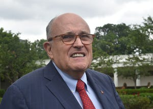 President Donald Trump's lawyer, Rudy Giuliani walks outside the White House before President Donald Trump delivers remarks and participates in the White House Sports and Fitness Day in Washington on May 30, 2018.