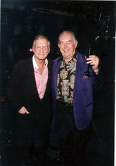Robin Leach with the late Hugh Hefner, at Studio 54 in Las Vegas in July 2002.